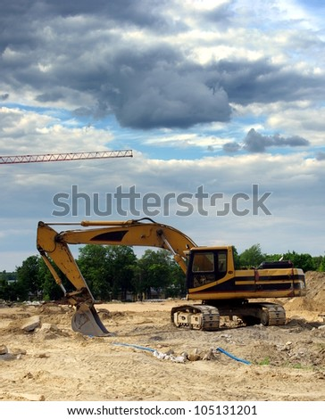 excavator on place of building