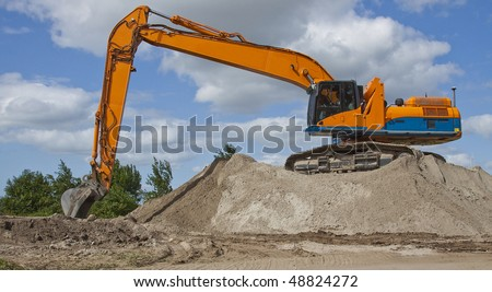 Excavator on sand - stock photo