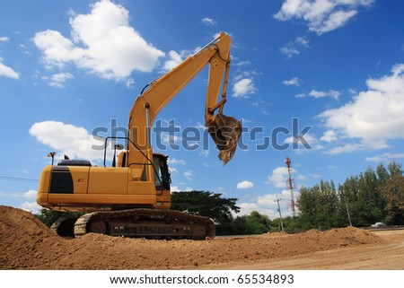 excavator on site working. - stock photo