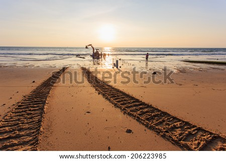 Excavator on the beach - stock photo