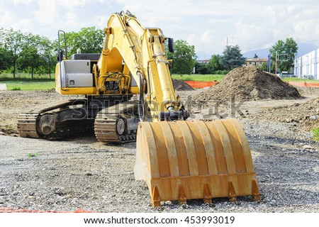 Excavator shovel at construction site by building a road. - stock photo