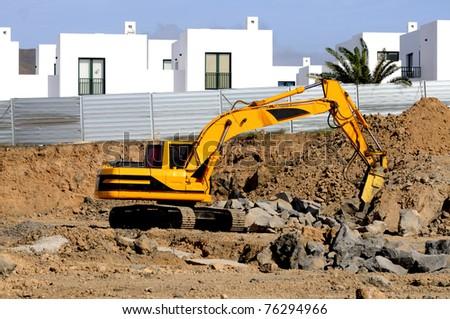 Excavator standing in sandpit - stock photo