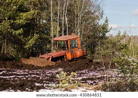 Excavator stucked in swamp - stock photo