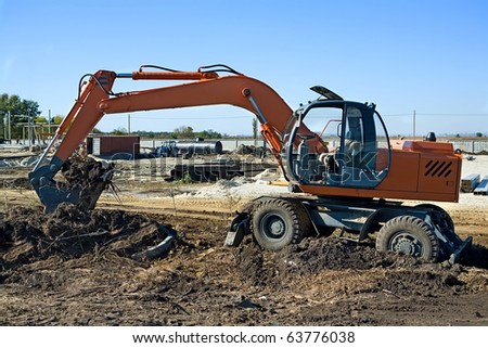 Excavator to dig the ground at a construction site