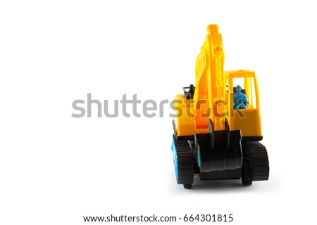 Excavator toy isolated on white background. Building concept