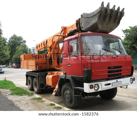 excavator waiting on the street - stock photo