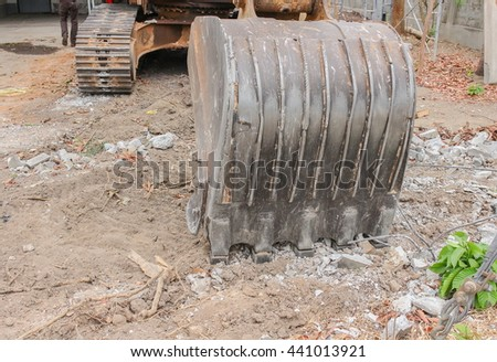 Excavator working.  Close up excavator destruction in Work outdoor construction : select focus front bucket Excavator : - stock photo