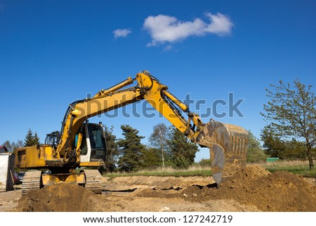 excavator working on a construction site - stock photo