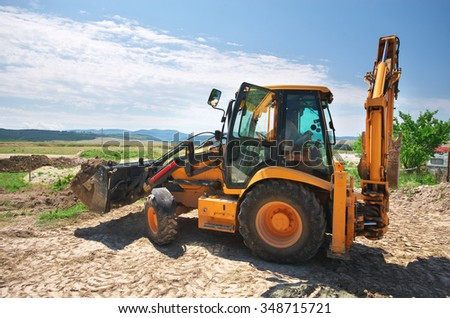 Excavator working on the ground. Building design. - stock photo