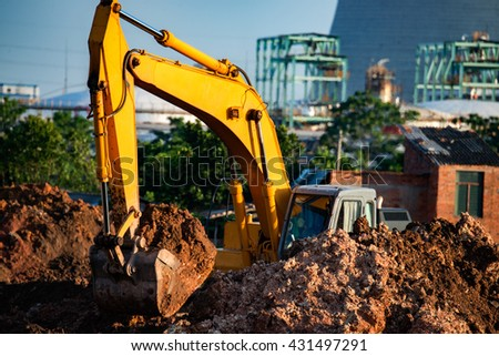 Excavators are assignments and refinery background - stock photo