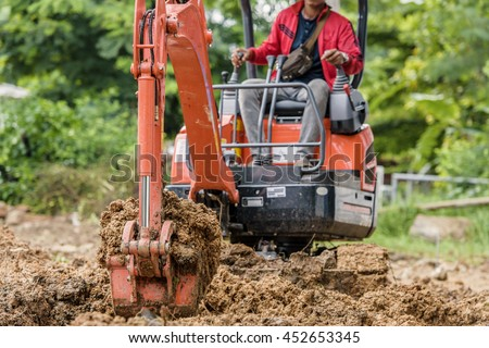 Excavators are digging small. - stock photo
