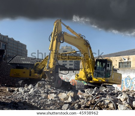 Excavators at a demolition site under a smoky environment. - stock photo