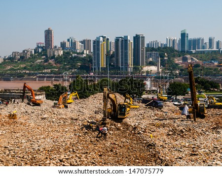 Excavators demolish old building (China) - stock photo