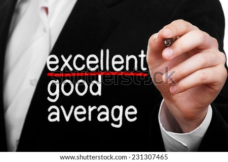 Excellence concept. Businessman writing excellent, good and average on transparent glass - stock photo