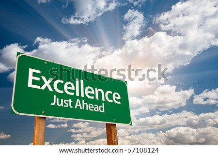 Excellence Just Ahead Green Road Sign with Dramatic Clouds, Sun Rays and Sky. - stock photo