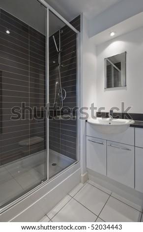 excellent en-suite bathroom with a shower cabin - stock photo