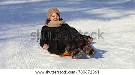Excellent mood for a woman on a sled. Walk on the winter slides.