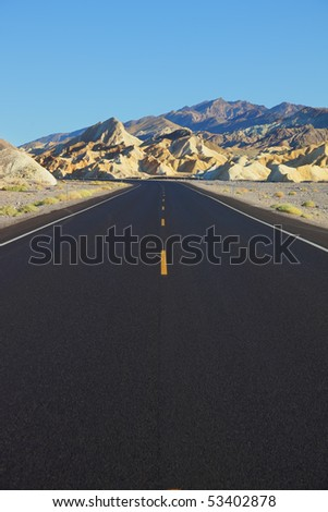 Excellent road in the desert. Black asphalt with an orange road markings - stock photo