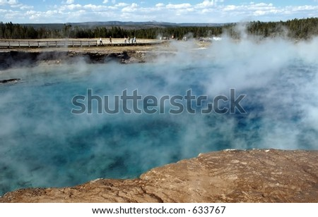 Excelsior Geyser and Tourists on Boardwalk - stock photo