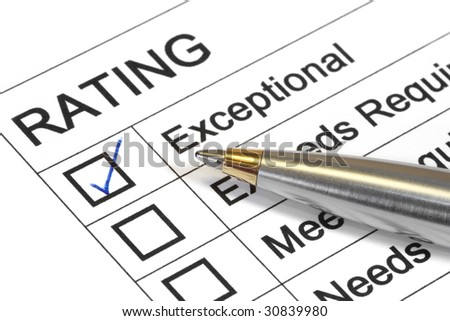 Exceptional rating marked with ballpoint pen.  Could be performance appraisal, customer service rating, business evaluation. - stock photo