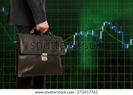 Exchange broker. Businessman with briefcase against the background of the exchange panel - stock photo