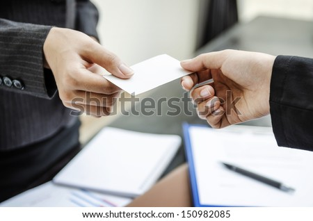 Exchange business card for first time meet - stock photo
