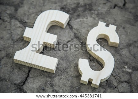 Exchange currency pound sterling and dollar on a dry land - stock photo