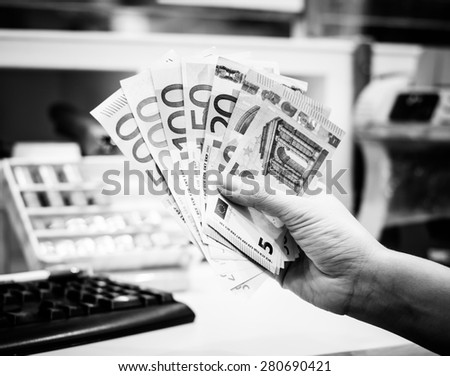 Exchange euro currency,money at counter in the bank branch on black and white color - stock photo