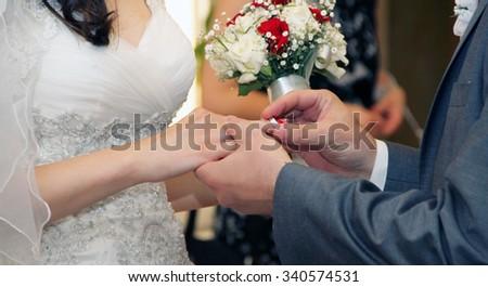 Exchange of wedding rings - stock photo