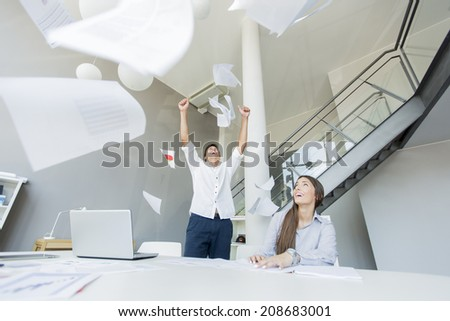 Excied business man in the office - stock photo