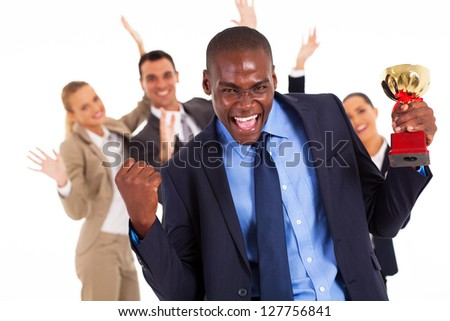 excited african american businessman winning a trophy - stock photo