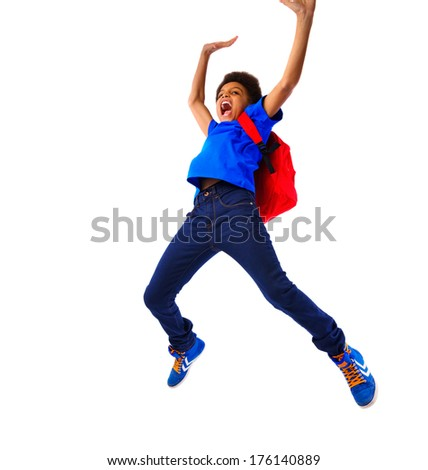 Excited African American school boy jumping happy, hands up, hanging on a board. Studio shot, isolated, over white background, with copy space. - stock photo