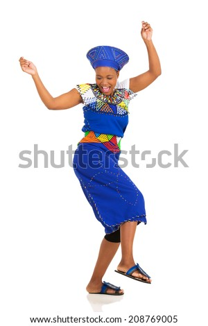 excited african woman in traditional clothes dancing - stock photo