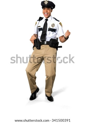 Excited African young man with short black hair in uniform holding handgun - Isolated - stock photo