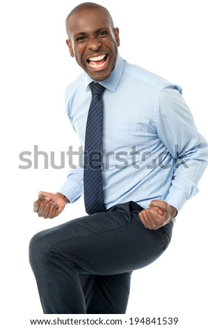 Excited aged businessman clenching fists - stock photo
