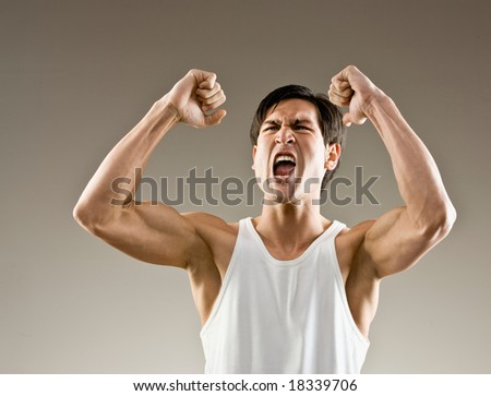 Excited and aggressive athlete cheering his success - stock photo