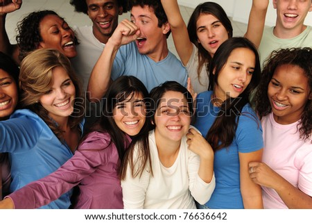 excited and happy group of diverse young people cheering - stock photo