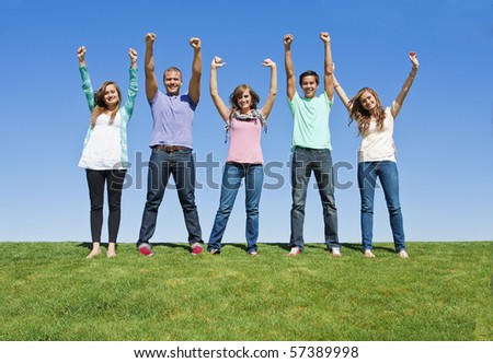 Excited and Happy Group of Young Adults - stock photo