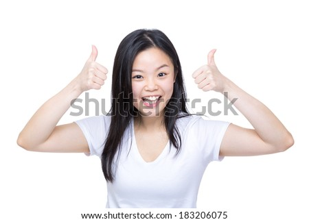 Excited asia woman thumb up - stock photo