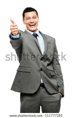 Excited Asian businessman giving thumbs up sign isolated on whit - stock photo