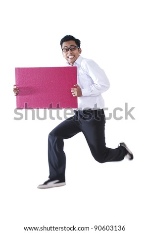 Excited Asian businessman jumping with blank sign - stock photo