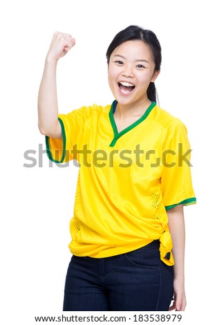 Excited asian female football supporter