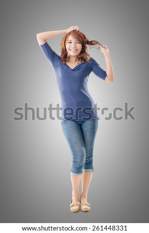 Excited Asian young girl, full length portrait isolated. - stock photo