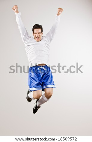Excited athlete in sportswear cheering and celebrating his success - stock photo