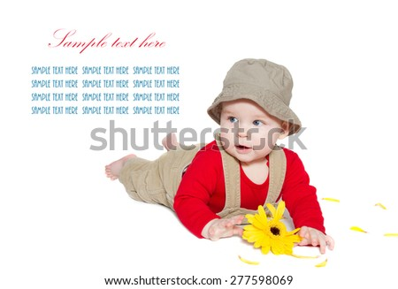 Excited baby explorer/farmer lays on stomach and holds gerbera on white background. looking at sample text   - stock photo