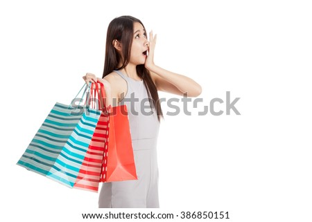 Excited beautiful young Asian woman with shopping bags  isolated on white background