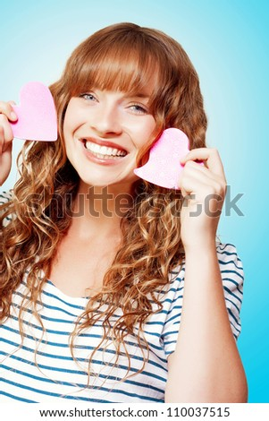 Excited birthday girl opening surprise gift with a look of amazement and shock in a Surprise Birthday concept on orange background - stock photo