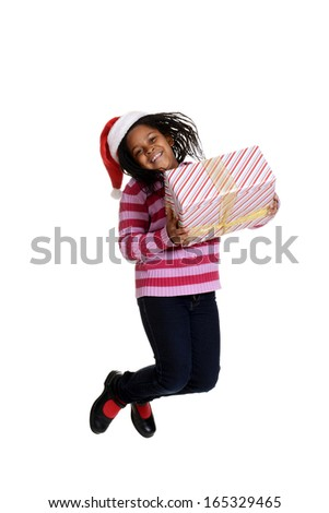 excited  black girl at Christmas - stock photo