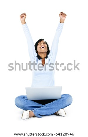 Excited black woman with arms raised and computer isolated on white background - stock photo