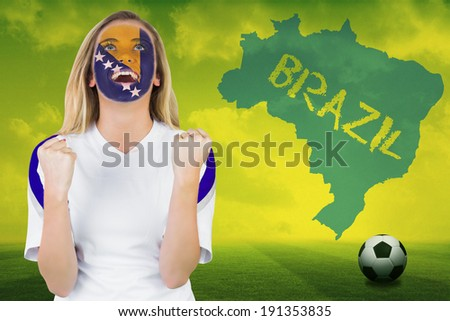 Excited bosnia fan in face paint cheering against football pitch with brazil outline and text - stock photo